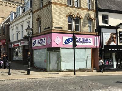 TO LET - Prime town centre lock-up retail unit
